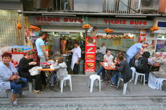 People eating at sidewalk cafe. People eating at a sidewalk café in the city of Istanbul in Turkey Royalty Free Stock Photography