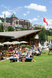 People eating and sunbathing at a restaurant at St. Moritz Royalty Free Stock Images