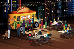 People Eating Taco at Taco Truck at Night. A vector illustration of People Eating Taco at Taco Truck at Night Stock Photo
