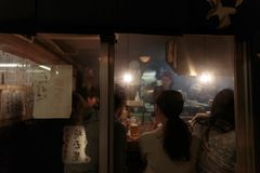 People eating at a traditional restaurant in Tokyo royalty free stock image