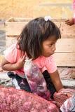 People in Ecuador. OTAVALO, ECUADOR - JAN 3, 2015: Unidentified Ecuadorian little girl with onion at the Otavalo Market. 71,9% of Ecuadorian people belong to the royalty free stock images