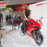 People at EICMA 2014 in Milan, Italy. MILAN, ITALY - NOVEMBER 5: People visit EICMA, international motorcycle exhibition on NOVEMBER 5, 2014 in Milan Royalty Free Stock Photo