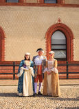 People in eighteenth century clothes Stock Images
