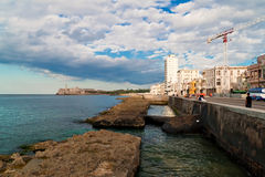 People  in El Malecon in Havana. People in El Malecon in Havana.El Malecon,a promenade running along the sea is among the attractions of Havana and a favourite Stock Images