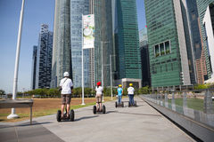 People on an electric scooter on the waterfront in Singapore Stock Image
