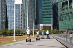 People on an electric scooter on the waterfront in Singapore Royalty Free Stock Photo