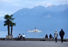 People at the embankment on Lake Geneva in Lausanne with Cruise stock images