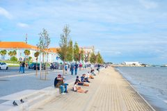 People embankment waterfront Lisbon Portugal stock image