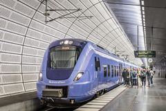 Free People Embark A Train At The Underground Station Triangeln In Malmo Royalty Free Stock Images - 153009189