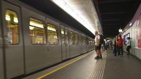 People embark to subway station train. VIENNA, AUSTRIA - AUGUST 2016: Empty u-bahn underground train arrives to a station Karlsplatz, people embark stock footage
