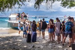 People embarking the ferry to Bali. People standing in line and embark the ferry to Bali, Gili Trawngan, Indonesia, April 26, 2018 stock photo