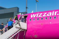 People embarking to Wizz Air plane at the airport. Gdansk, Poland - May 28, 2018: People embarking to Wizz Air plane at the airport royalty free stock photo