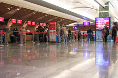 People at the Emirates counters inside the Taiwan Taoyuan International Airport. Taipei, Taiwan - January 9, 2015: People at the Emirates counters inside the Stock Images