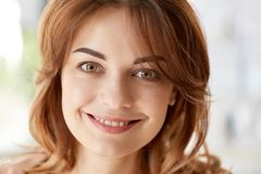 Portrait of happy smiling young woman. People, emotion and facial expression concept - portrait of happy smiling young woman Royalty Free Stock Image