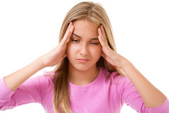 People, emotions, stress and health care concept - unhappy young. Girl touching her head and suffering from headache over white background Royalty Free Stock Images