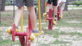 People Engage in Sports Training Equipment on the Street stock video footage