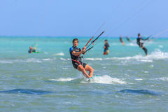 People engaged in kite surfing Royalty Free Stock Images