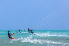 People engaged in kite surfing Stock Photography