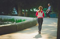 People are engaged in running in the City Park named after Gorky every morning royalty free stock photos