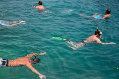 People engaged in snorkeling, Andaman Sea, Thailand. Stock Images