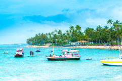 People Enjoy A Sunny Day At Praia Do Forte In Bahia, Brazil Stock Photography