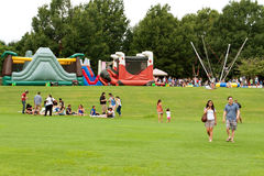 People Enjoy Activities And Relaxing On Grass At Summer Festival Royalty Free Stock Photos