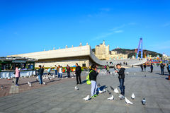People enjoy the activities in Xinghai Square. Dalian, China - April 7, 2015 : People enjoy the activities in Xinghai Square. The Square covers total area of 1.1 stock images
