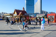People enjoy the activities in Xinghai Square. Dalian, China - October 10, 2015 : People enjoy the activities in Xinghai Square. The Square covers total area of stock images