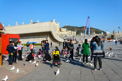 People enjoy the activities in Xinghai Square. Dalian, China - October 10, 2015 : People enjoy the activities in Xinghai Square. The Square covers total area of royalty free stock photography