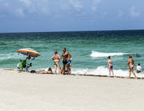 People enjoy the afternoon light at south Beach Royalty Free Stock Image