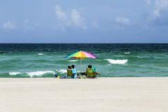 People enjoy the afternoon light at south Beach Stock Images