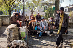 People enjoy afternoon sun on the warm evening in Monmartre hill. Stock Photography