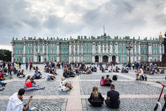 People enjoy the art of street musician in the Palace Square, St Royalty Free Stock Image