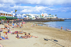 People enjoy the artifical beach Playa Dorada Stock Images