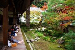 People enjoy autumn garden at Eikando, Kyoto. KYOTO, JAPAN - NOVEMBER 13, 2015: Unidentified people enjoy autumn foliage garden at Eikando temple. Here is the stock images