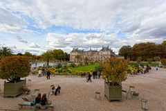 People enjoy autumn sunny day in the Luxembourg Garden Royalty Free Stock Photo