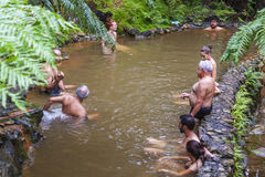 People enjoy bath in natural thermal pools, Azores, Portugal stock images