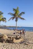 People enjoy the beach in Arrecife and builf castles with sand u. ARRECIFE, SPAIN - MAR 29, 2013: people enjoy the beach in Arrecife and builf castles with sand stock photo