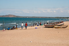 People enjoy the beach at Lake Malawi. Royalty Free Stock Image