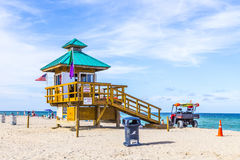 People enjoy the beach at sunny isles protected by lifeguards in Royalty Free Stock Photography