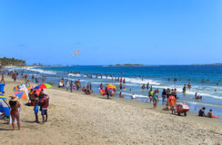 People enjoy on the beach in Venezuela. PUERTO CABELLO, VENEZUELA- JUNE 24, 2014: Unidentified people enjoy on the beach during a national holiday royalty free stock images
