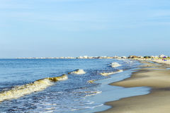 People enjoy the beautiful beach in late afternoon  at Dauphin I. Beautiful beach in early morning  at Dauphin Island, USA Stock Image