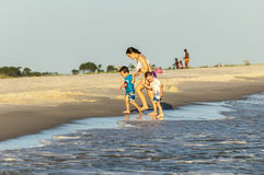 People enjoy the beautiful beach in late afternoon  at Dauphin I Stock Photos