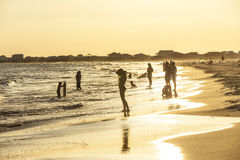 People enjoy the beautiful beach in late afternoon  at Dauphin I Royalty Free Stock Photos