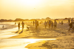 People enjoy the beautiful beach in late afternoon Royalty Free Stock Photos