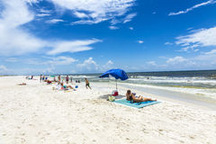People enjoy the beautiful beach at Niceville. NICEVILLE, USA - JULY 21, 2013: people enjoy the beautiful beach at Niceville, USA. The adjacent cities of Royalty Free Stock Photography