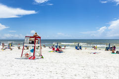 People enjoy the beautiful beach at Niceville. NICEVILLE, USA - JULY 21, 2013: people enjoy the beautiful beach at Niceville, USA. The adjacent cities of Stock Image