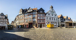 People enjoy the beautiful medieval market place in Butzbach. BUTZBACH, GERMANY - JUNE 4, 2015: people enjoy the beautiful medieval market place in Butzbach royalty free stock photos