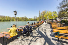People enjoy the beautiful weather at the Seehaus in Munich. MUNICH, GERMANY - APR 20, 2015: people enjoy the beautiful weather at the Seehaus in Munich, Germany royalty free stock photos