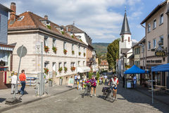 People enjoy a bicycle tour in the beautiful historic town of Ko. KOENIGSTEIN, GERMANY - SEP 27, 2009: people enjoy a bicycle tour in the beautiful historic town stock image